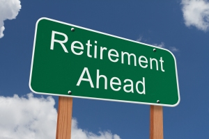 Retirement Ahead Sign Green highway sign with words Retirement Ahead with blue sky background